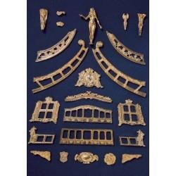 Cast brass decoration set...